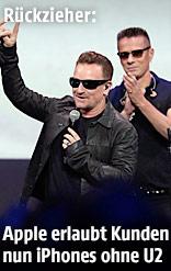 U2 und Apple-Chef Cook bei der Präsentation von neuen Produkten