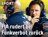 Red-Bull-Team an der Boxenwand