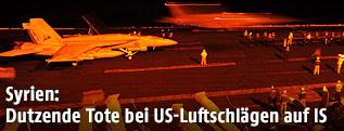 US-Kampfjets starten auf einem Flugzeugträger