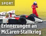 Ayrton Senna wird 1989 in seinem Auto weggeschoben, während Alain Prost davongeht