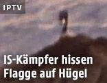 IS-Flagge auf einem Hügel