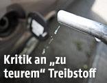 Benzin tropft aus einem Zapfhahn
