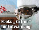"""Ein Mitarbeiter der """"Ärzte ohne Grenzen"""" (MFS) in Schutzanzug"""