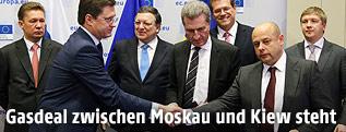 Energieminister von Russland und der Ukraine geben sich die Hand