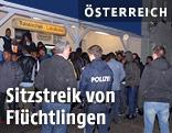 Asylwerber und Polizisten am Bahnhof in Traiskirchen