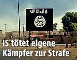 Tafel mit IS-Fahne in einer irakischen Ortschaft