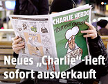 "Person liest ""Charlie Hebdo"""