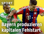 Naldo und Daniel Caligiuri (Wolfsburg) gegen Robert Lewandowski (Bayern München)