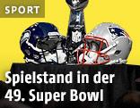 Helme der Seattle Seahawks und New England Patriots vor der Super-Bowl-Trophäe