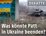 Panzer und Holzhütte mit aufgemalter ukrainischen Flagge