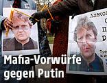 Demonstranten halten Plakate mit einem Bild von Alexander Litwinenko