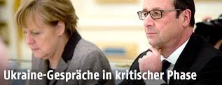 Deutsche Kanzlerin Merkel und französischer Präsident Hollande