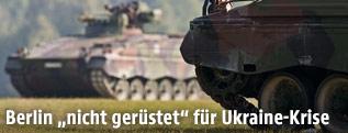 Deutsche Panzer auf einer Wiese