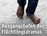 Füße eines Flüchtlings