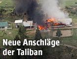 Rauch steigt von der Absturzstelle eines Hubschraubers in Pakistan auf