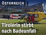 Notarzthubschrauber und Rettungswagen vor dem Hallenbad in Seefeld