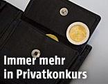 Geldtasche mit Münze