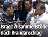 Israelischer Polizist diskutiert mit einem Palästinenser