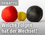 Eine rote, eine gelbe und eine schwarze Plastilinkugel symbolisieren SPÖ, Team Stronach und ÖVP