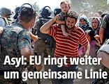 Vater und Sohn bei der griechisch-mazedonischen Grenze