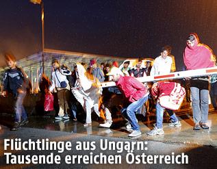 Flüchtlinge an der österreichischen-ungarischen Grenze