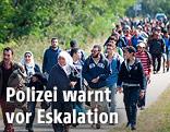 Flüchtlinge an österreichisch-ungarischer Grenze
