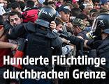 Flüchtlinge und Polizeikräfte an der ungarisch-serbischen Grenze