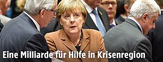 EU-Kommissionspräsident Jean-Claude Juncker und die deutsche Kanzlerin Angela Merkel