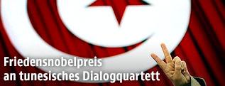 Tunesische Flagge und Hand mit Peace/Victory-Zeichen