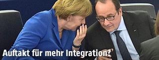 Deutsche Bundeskanzlerin Angela Merkel und Frankreichs Präsident Francois Hollande