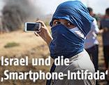 Vermummter Palästinenser mit Smartphone