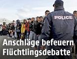 Polizist und Flüchtlinge