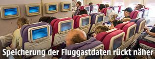 Passagiere in einem Flugzeug