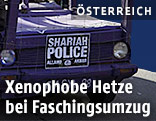 """Fahrzeug bei Faschingsumzuge mit Schild""""Scharia Police"""""""