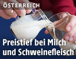 Milchkanne und Glas mit Milch
