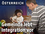 Mann betreut ein Flüchtlingskind