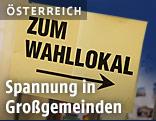 """Zettel mit Pfeil und Aufschrift """"Zum Wahllokal"""""""