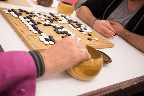 Menschen spielen Go