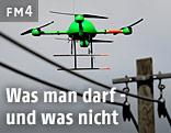Ferngesteuerte Drohne nahe an Stromkabeln