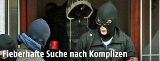 Maskierte Belgische Polizisten