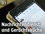 Twitter Seite auf einem Mobiltelefon