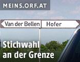 """Zwei Wegweiser mit der Aufschrift """"Van der Bellen"""" und """"Hofer"""""""