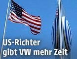 US-Flagge neben VW-Logo