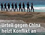 Chinesische Soldaten auf den Spratly-Inseln