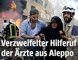 Eine Frau in Aleppo wird in Sicherheit gebracht