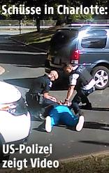 Video zeigt den Verdächtigen am Boden, umringt von Polizisten