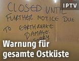 """Schild mit der Aufschrift """"Closed until further notice due to earthquake damage. Sorry."""""""