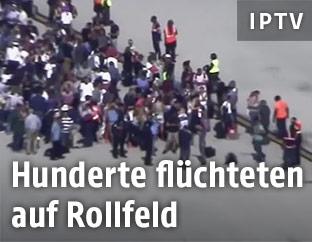 Menschen am Rollfeld