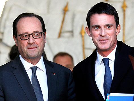 Frankreichs Präsident Francois Hollande und Manuel Valls