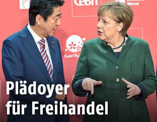 Deutsche Kanzlerin Merkel und japanischer Premier Abe